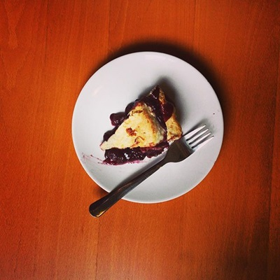 single piece of blueberry pie on a table