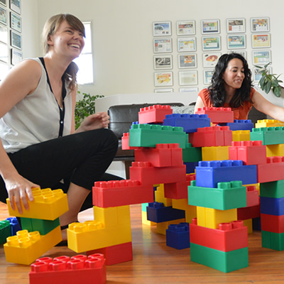 Women building large legos