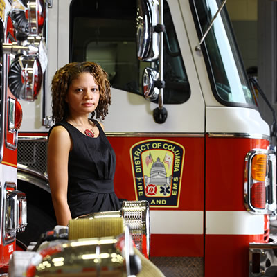 woman next to fire truck