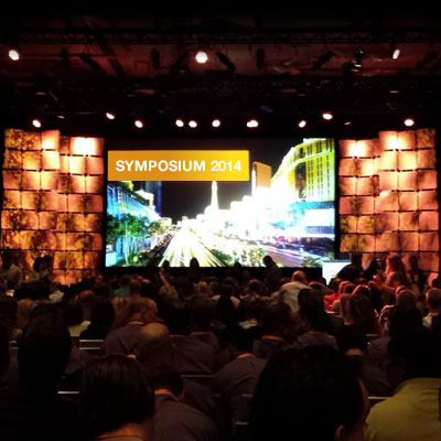 A shot of a jumbotron and a crowd at the Sitecore Symposium
