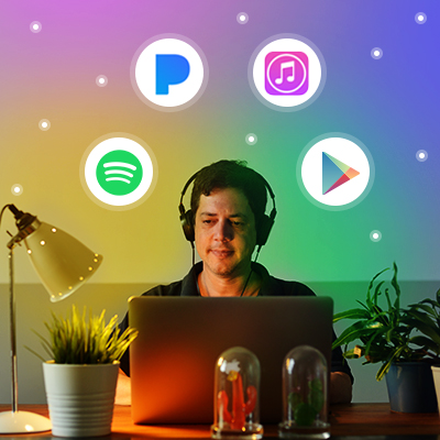 man at computer listening to music with music streaming icons