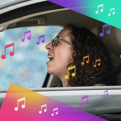 woman singing in her car