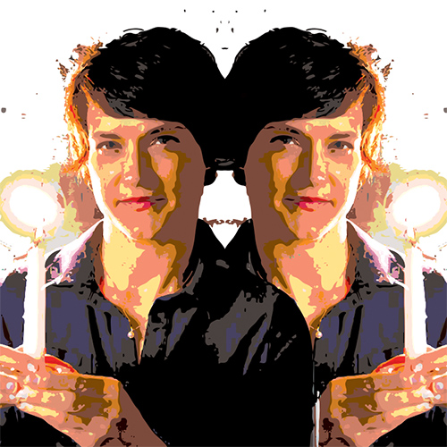woman holding candle and her reflection