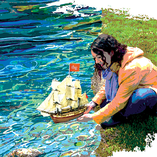 woman launching toy boat on water