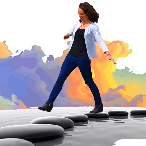 woman stepping from stone to stone